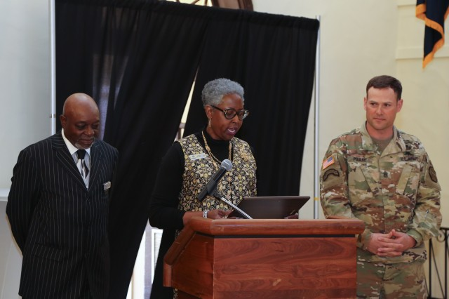 FORT BENNING, Ga. (March 9, 2018) -- Ann Jones, center, of Army Community Service, reads a certificate aloud before presenting it to Command Sgt. Maj. William D. Pouliot, right, command sergeant major of U.S. Army Garrison Fort Benning command sergeant major; Lionel Grant, left, Fort Benning Army Emergency Relief officer, also spoke during the AER kickoff event March 8 at the Benning Club. The Fort Benning Army Emergency Relief staff kicked off the monthlong AER fundraising campaign during a ceremony at the Benning Club at Fort Benning, Georgia, March 8. AER, a non-profit organization, provides financial assistance to service members and their Families in the form of no- or low-interest loans, grants and scholarships. (U.S. Army photo by Markeith Horace, Maneuver Center of Excellence, Fort Benning Public Affairs)
