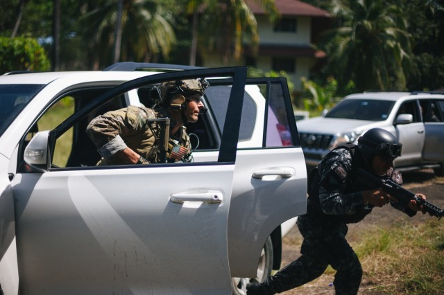 U.S. Special Forces and Panamanian security forces rush to rescue simulated hostages Feb. 1, 2018, during a training exchange in Colon, Panama, aimed at improving U.S. response capabilities and fostering partnerships in the Americas.