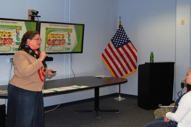 Lori Owens, a master resiliency trainer in ASC's Wellness Division who is leading the Fit Food Challenge, speaks at a kickoff event held for initiative on March 1 at Rock Island Arsenal, Illinois. (Photo by Paul Levesque, ASC Public Affairs)