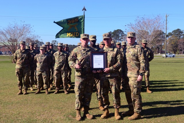 Command Sgt. Maj. Michael Grinston, command sergeant major for U.S. Army Forces Command, presents the Soldiers of the Headquarters and Headquarters Detachment, 385th Military Police Battalion, with the FORSCOM Readiness Trophy (Eagle Award) March 8, 2018, on Dragoon Field at Fort Stewart, Ga. Grinston visited the 3rd Infantry Division 385th MP Bn. and Soldiers of 2nd Armored Brigade Combat Team  and recognized several Soldiers for their excellent achievements. (U.S. Army photo by Spc. Noelle E. Wiehe, 50th Public Affairs Detachment, 3rd Infantry Division/ Released)