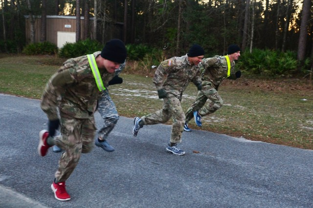 Command Sgt. Maj. Michael Grinston, command sergeant major for U.S. Army Forces Command, middle, conducts physical training with Soldiers of the 385th Military Police Battalion at Fort Stewart, Ga., March 8, 2018, before running through the Marne Mile. Grinston visited the battalion to present the Headquarters and Headquarters Detachment, 385th MP Bn., the FORSCOM Readiness Trophy (Eagle Award). (U.S. Army photo by Spc. Noelle E. Wiehe, 50th Public Affairs Detachment, 3rd Infantry Division/ Released)