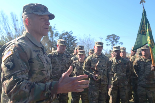 Command Sgt. Maj. Michael Grinston, command sergeant major for U.S. Army Forces Command, speaks to Soldiers of the 385th Military Police Battalion after presenting the Headquarters and Headquarters Battalion with the FORSCOM Readiness Trophy (Eagle Award) March 8, 2018, on Fort Stewart, Ga.