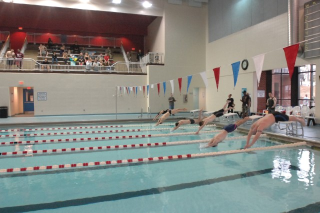Swimmers dive into the Davidson Fitness Center natatorium Feb. 24 during the annual Commander's Cup Swim Meet. The facility will be used by Waynesville High School swimmers in the fall with the beginning of a new school year.