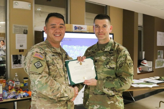 Capt. Vu Mai, Engineer Officer, North Atlantic Division, U.S. Army Corps of Engineers receives Army Achievement Medal from for his work as a Battle Captain from Lt. Col. Cullen Jones, deputy commander, Task Force Power Restoration in San Juan, P.R.