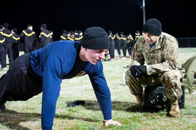 A Lieutenant assigned to the 5th Squadron, 73rd Cavalry Regiment, 3rd Brigade Combat Team, 82nd Airborne Division conducts the push-up portion of an Army Physical Fitness Test March 8th as part of the Janney Cup, an annual competition held to determine the brigade's top Lieutenant.  The brigade hosts the Janney Cup each year in honor of 2nd Lt. Richard Janney, a member of the 505th Parachute Infantry Regiment killed during the Normandy Invasion when the vehicle he was driving struck a land mine.