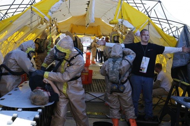 Army National Guard Soldiers with the Oregon National Guard's Chemical, Biological, Radiological, Nuclear and Explosive (CBRNE) Enhanced Response Force Package (CERFP), work to decontaminate simulated patients during Exercise Vigilant Guard, March 6, 2018, at Great Falls, Montana. Vigilant Guard is a United States Northern Command and National Guard Bureau sponsored exercise program. Exercises are held in a different state each year. These exercises help National Guard personnel refine their response for domestic operations and build a closer relationship with community and state departments.