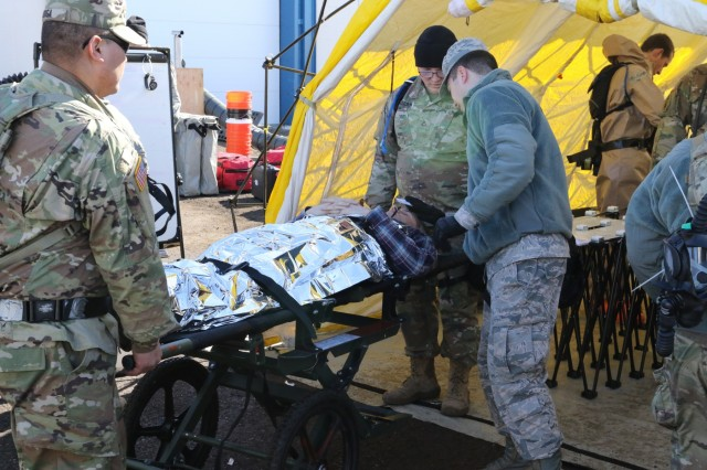 Army and Air National Guardsmen with the Oregon National Guard's Chemical, Biological, Radiological, Nuclear and Explosive (CBRNE) Enhanced Response Force Package (CERFP), work together to assess and treat simulated contaminated patients during Exercise Vigilant Guard, March 6, 2018, at Great Falls, Montana. Vigilant Guard is a United States Northern Command and National Guard Bureau sponsored exercise program. Exercises are held in a different state each year. These exercises help National Guard personnel refine their response for domestic operations and build a closer relationship with community and state departments.