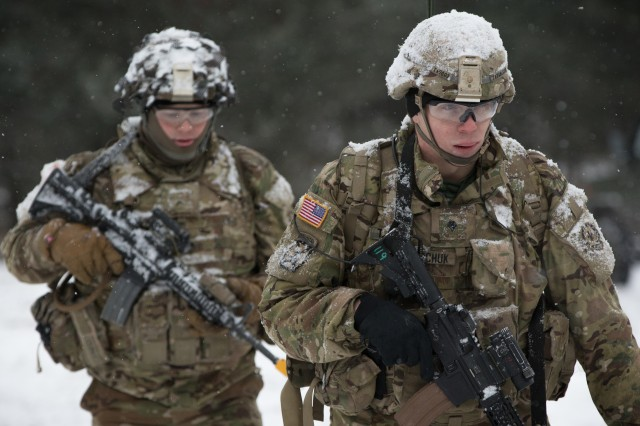 U.S. Soldiers assigned to Lightning Troop, 3rd Squadron, 2nd Cavalry Regiment, move from one position to another while pulling security during Command Post Exercise Weasel near the Bemowo Piskie Training Area, Poland, Feb. 6, 2018. Training exercises such as this will continue to help Soldiers increase their lethality for future combat, according to Gen. Stephen Townsend.