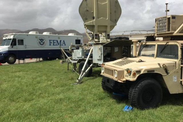 The Army's 63rd Expeditionary Signal Battalion (ESB), 35th Signal Brigade's robust unified  Tactical Network Transport Equipment (Satellite Transportable Terminal seen center with Joint Network Node the lower right vehicle) is the only source of communications for the air traffic control tower at the Rafael Hernández Airport in Aguadilla, on Oct. 5, 2017.