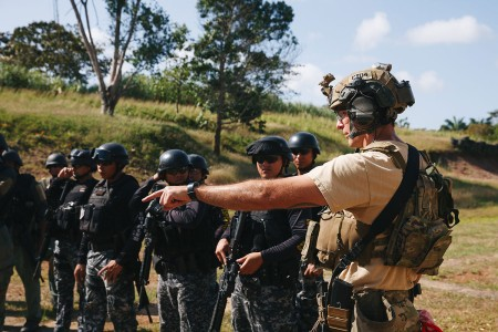 A Special Forces Soldier explains range procedures to Panamanian counterterrorism security forces, Jan. 30, 2018, during joint combined marksmanship training in Panama City, Panama. Marksmanship training is necessary before combined forces conduct interoperability training.