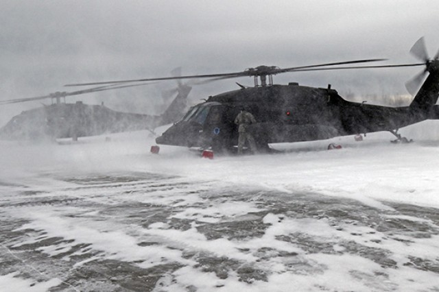 Alaska National Guard Soldiers with Alpha Company, 1st Battalion, 207th Aviation Regiment prepare to embark from the Bryant Army Airfield on Joint Base Elmendorf-Richardson, Alaska, in their UH-60 helicopters in support of a training mission several miles north of the Alaskan coastline Mar. 4, 2018.