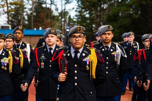 Students stand at parade rest while waiting for their final score following an Armed platoon exhibition during the North Springs Charter High School Invitational Drill Meet. U.S. Army Soldiers from the 335th Signal Command (Theater), and Georgia Recruiting Battalion, U.S. Army Recruiting Command served as judges and mentors for Georgia area Junior Reserve Officer Training Corps (JROTC) students from 13 high schools at the North Springs Charter High School Invitational Drill Meet held in Atlanta, Feb. 24, 2018. (U.S. Army Reserve photo by Capt. David Gasperson)