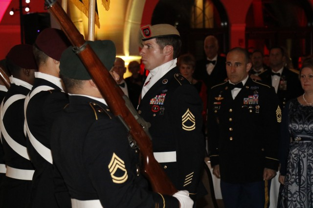 1st Sgt. Jarrid Collins, the senior enlisted advisor for Headquarters and Headquarters Company, Special Warfare Medical Group (A), Fort Bragg, North Carolina, looks on during the entrance of the colors at the U.S. Army Special Operations Command Black and Red Ball, Fayetteville, North Carolina, Saturday, March 3, 2018.
