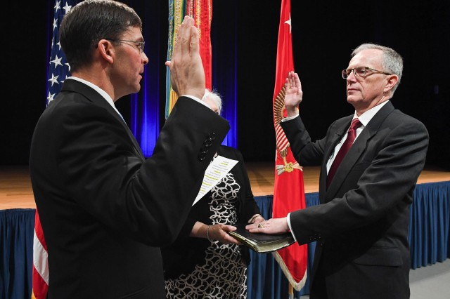 Secretary of the Army Dr. Mark D. Esper, left, swears in Dr. Bruce D. Jette as the new assistant secretary of the Army for Acquisition, Logistics, and Technology during a ceremony at the Pentagon, March 9, 2018.