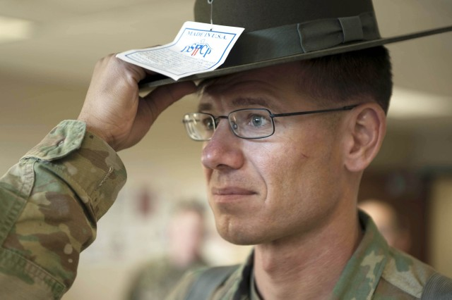 "SSG Broadhead receives a campaign hat at Fort Jackson, South Carolina.  He is one of 84 noncommissioned officers to complete the first of what is expected to be seven ten-week ""conversion"" courses that turn AIT platoon sergeants into drill sergeants.  The first course graduated March 9, 2018, at Fort Jackson, South Carolina."