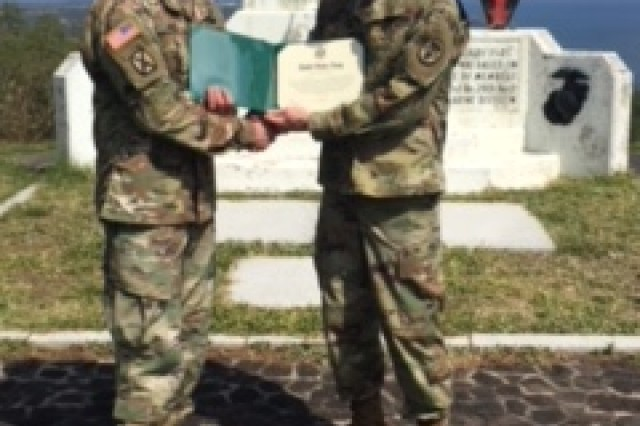On Feb. 22, 2018, Capt. Jason Hyde (R) presents Sgt. Eric Smith (L) his certificate during a reenlistment ceremony on top of Mount Suribachi in Japan.