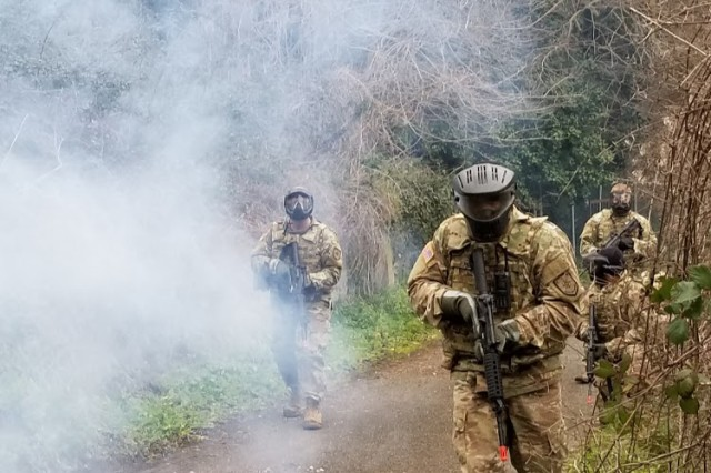 "Moving cautiously through the smoke of a training ""village"", Soldiers, Sailors and Airmen conducted reconnaissance and squad movement techniques during a training exercise in Carney Park, Naples, Italy Feb. 19-23. (photo by Staff Sergeant Stephanie Walker, DCM A, 2nd NATO Sig. Bn.)"