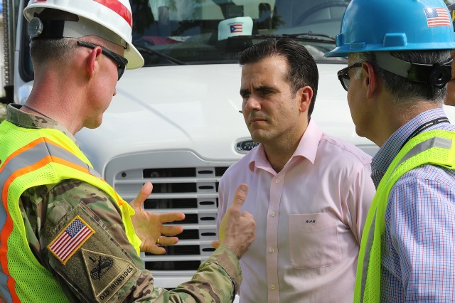 Col. Jason Kirk, left, Task Force Power Restoration Commander, speaks with Gov. Ricardo Rossello, Governor of Puerto Rico in Bayamon, Puerto Rico, as power was being restored to a neighborhood, Feb. 05, 2018. The U.S. Army Corps of Engineers is working in a unified effort with the Puerto Rico Power Authority, FEMA and industry partners to help people recover from the damage caused by hurricane's Irma and Maria.