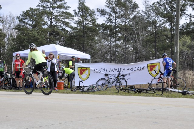 FORT BENNING, Ga. -- Cyclists partake in food and refreshments at a rest stop sponsored by the 316th Cavalry Brigade at Fort Benning during the Fort Benning Centennial Century Bike Ride at Columbus, Georgia, March 10, 2018. The 100-mile bike race, which leads cyclists through Fort Benning and downtown Columbus, takes place during the the year-long celebration of Fort Benning's 100th anniversary. (U.S. Army photo by Jessica Dupree/Released)