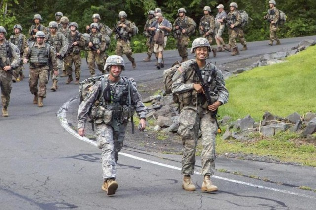 Cadet Simone Askew (right) leads her freshmen class on a road march at the U.S. Military Academy.