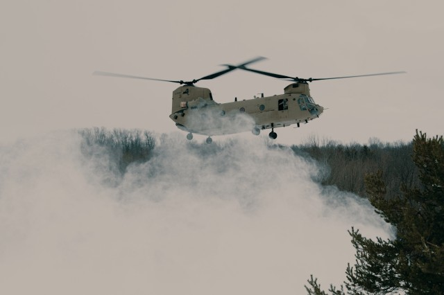A CH-47 Chinook helicopter assigned to Bravo Company, 3rd Battalion, 126th Aviation Regiment, New York Army National Guard, prepares to land and insert Soldiers of Charlie Troop, 2nd Battalion, 101st Cavalry Regiment, New York Army National Guard, into their landing zone, Java Center, N.Y., March 10, 2018. The more than 40 Soldiers will spend two days training in harsh conditions on reconnaissance tactics, utilizing infiltration and exfiltration techniques by helicopter.