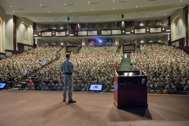 Lt. Gen. Patrick Sanders, CBE, DSO, Commander Field Army, British Army, delivers the annual Kermit Roosevelt Exchange Lecture at the U.S. Army Command and General Staff College March 8 to an audience of more than 1,400 students and instructors from CGSC and the United Kingdom's Intermediate Command and Staff College (Land). More than 200 British officers were at Fort Leavenworth to participate in Exercise Eagle Owl.