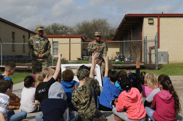 Soldiers assigned to 96th Transportation Company, 553rd Combat Sustainment Support Battalion, 1st Cavalry Division Sustainment Brigade, answer students' questions at the Western Hills Elementary School Career Day in Temple, Texas, March 8. Western Hills is one of five schools sponsored by the brigade as part of the Adopt-a-School program.