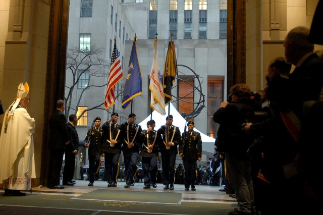 The Color Guard of the New York Army National Guard's 1st Battalion 69th Infantry leads the battalion into New York City's St. Patrick's Cathedral prior to marching in the annual St. Patrick's Day Parade on March 17, 2015. A special mass is held for the Soldiers of the 69th each year before the start of the parade. The 69th Regiment, who possesses a historical Irish-American makeup, has lead the parade since 1851.