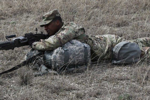 """A soldier pulls security at one of the six stations each team had to compete in at the 553rd Combat Sustainment Support Battalion's """"Best Squad Competition"""" on Fort Hood, Texas, March 8.  One team from each of the seven companies in the battalion competed, and 664th Ordnance Company took home the winning trophy."""