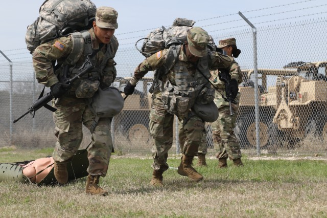 """Two soldiers compete in the skedco litter pull at the medical lane of 553rd Combat Sustainment Support Battalion's """"Best Squad Competition"""" on Fort Hood, Texas, March 8. The first competition of its kind for the battalion, was won by 664th Ordnance Company and will be held quarterly from now on."""