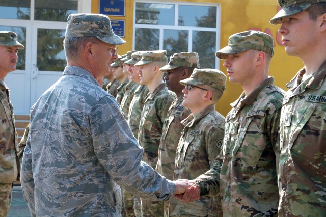 Maj. Gen. Anthony German, the 53rd Adjutant General for the State of New York, recognized Spc. Jeffrey Maziarz of Tonawanda, NY, assigned to the Joint Multinational Training Group - Ukraine, with a challenge coin. Currently more than 220 New York Army National Guard Soldiers are assigned to the Combat Training Center where they are helping to mentor Ukrainian units as they work to achieve NATO interoperability.