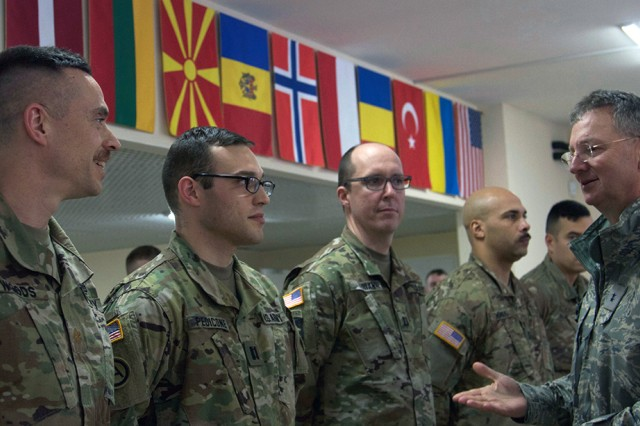Maj. Gen. Anthony German, New York's adjutant general, spoke with officers and non-commissioned officers of the Simulations Center assigned to the Joint Multinational Training Group-Ukraine on March 8, 2018, in Yavoriv. More than 220 New York Army National Guard Soldiers are assigned to the Combat Training Center where they are helping to mentor Ukrainian units as they work to achieve NATO interoperability.