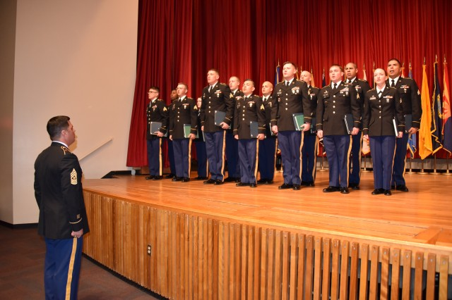 Command Sgt. Maj. Scott Sutherland, 1st Space Brigade, U.S. Army Space and Missile Defense Command/Army Forces Strategic Command, leads newly inducted noncommissioned officers in the Creed of the NCO during a ceremony at Fort Carson, Colorado, March 9.