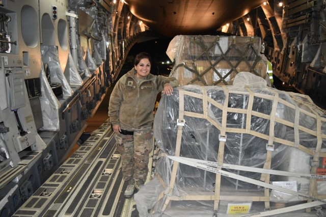 U.S. Army Staff Sgt. Bina K. Cheema stands with packaged Microwave Line-of-Sight radios aboard a C-17 Globemaster III, Bagram Airfield, Afghanistan, Feb. 18. After extensive coordination to prepare and ship the radios under a compressed schedule, Cheema traveled to Afghanistan with them to ensure timely delivery. The radios are part of the effort to meet increased communications requirements in direct support of the change in U.S. strategy in Afghanistan. (U.S. Army Reserve photo by Maj. Andrew Benbow)