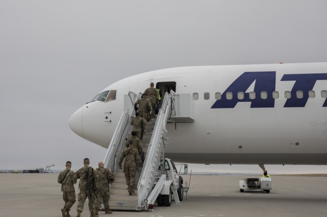 Soldiers from 3rd Squadron, 61st Cavalry Regiment, 2nd Infantry Brigade Combat Team, 4th Infantry Division, board an aircraft, Feb. 19, 2018, as they depart Fort Carson, Colorado to begin their ten-month deployment to Kosovo. Soldiers from 3-61st Cav. Reg. will be conducting security operations, working alongside North Atlantic Treaty Organization forces, and building relationships with the local populace. (U.S. Army photo by Staff Sgt. Neysa Canfield/ 2IBCT Public Affairs)
