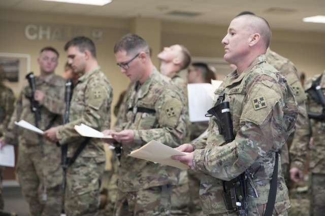 Soldiers from the 3rd Squadron, 61st Cavalry Regiment, 2nd Infantry Brigade Combat Team, 4th Infantry Division, wait in line for inspection, Feb. 19, 2018, before boarding an aircraft to depart Fort Carson, Colorado and begin their ten-month deployment to Kosovo. (U.S. Army photo by Staff Sgt. Neysa Canfield/ 2IBCT Public Affairs)