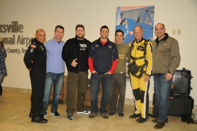 Maj. Gen. Andrew Poppas (right), 101st Airborne Division (Air Assault) commander, poses for a photo with Lee Hediger (second from right), Providence Wealth Advisors co-founder, The Veterans Trust members, and Lt. Col. Carlos Ramos (left), U.S. Army Parachute Team Golden Knights commander, at Outlaw Field, Clarksville Regional Airport, March 2.  Several Screaming Eagle Soldiers partnered with prominent city officials and key leaders from Kentucky and Tennessee to participate in a two-day tandem jump with the U.S. Army's Golden Knights Parachute Team.  The event was part of the Total Army Recruitment Effort, which aims to expand Army awareness by introducing key community leaders and service members to some of the capabilities that the U.S. Army has to offer. (U.S. Army photo by Staff Sgt. Lerone Simmons, 101st Airborne Division