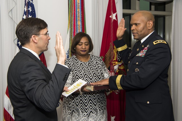 Secretary of the Army Mark T. Esper, left, swears in then-Maj. Gen. Leslie C. Smith as the 66th inspector general of the Army during a ceremony in the secretary's office in the Pentagon Feb. 7. Two days later, Smith was promoted to lieutenant general.