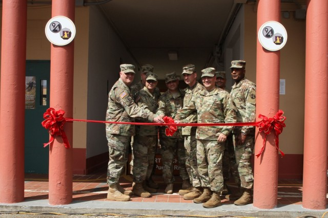 Maj. Gen. Bruce Hackett, commanding General of the 80th Training Command, and Brig. Gen. Hector Lopez, commanding general of the 94th Training Division, take part in the ribbon-cutting ceremony at Fort Buchanan, Puerto Rico to celebrate the reopening and relocation of a schoolhouse for the 94th Training Division's 5th Battalion on 13 February 2018. The 5th BN's previous schoolhouse was severely damaged by the devastation of Hurricane Maria. Maj. Gen. Hackett and Brig. Gen. Lopez were also on the island to assist with the planned tranistion and approved reassignment of all units stationed in Puerto Rico to the operational control of the 1st Mission Support Command. Photo by Army Master Sgt. Benari Poulten, 80th Training Command (TASS) Public Affairs