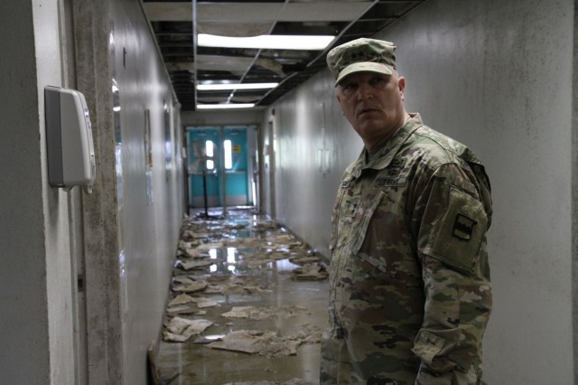 Maj. Gen. Bruce Hackett, commanding General of the 80th Training Command witnesses some of the devastation of Hurricane Maria at a severely damaged training facility on 14 February 2018. Maj. Gen. Hackett and Brig. Gen. Hector Lopez were on the island to celebrate the reopening and relocation of a new schoolhouse for the 94th Training Division's 5th Battalion, as well as to assist with the planned tranistion and approved reassignment of all units stationed in Puerto Rico to the operational control of the 1st Mission Support Command. Photo by Army Master Sgt. Benari Poulten, 80th Training Command Public Affairs.