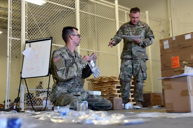 Soldiers conduct a joint inventory of new medical equipment and supplies during fielding operations with the U.S. Army Medical Materiel Agency.