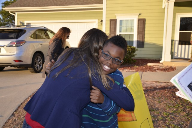 Maurquez Smith, a fourth-grade student, is given a congratulatory hug for meeting his reading goals March 8 as C.C.Pinckney and Pierce Terrace Elementary schools conducted its annual Reading Prize Patrol.