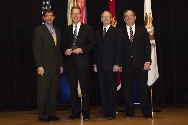 From left: Dr. Mark T. Esper, Secretary of the U.S. Army; Thomas Coradeschi, Chief, Systems Engineering and Technology Integration Division, within the Project Manager Maneuver Ammunition Systems; Honorable Dr. Bruce D. Jette , Assistant Secretary of the Army (Acquisition, Logistics and Technology) and the Acquisition Executive; Jeffrey White, Principal Deputy to the ASA(ALT).