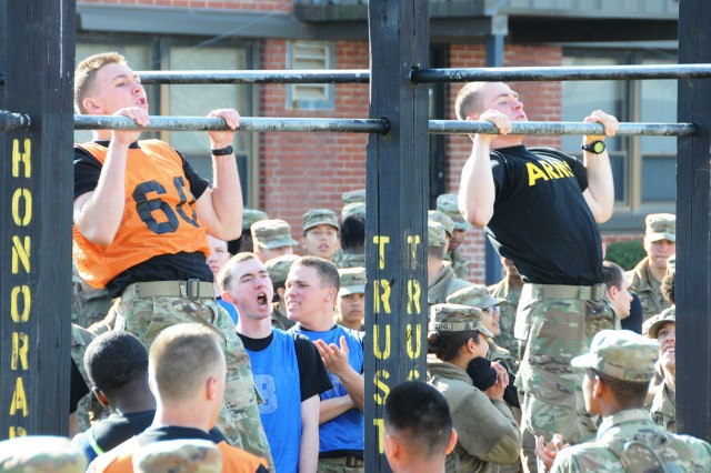 Soldiers participate in the pull-up portion of the AIT Warrior competition March 10.