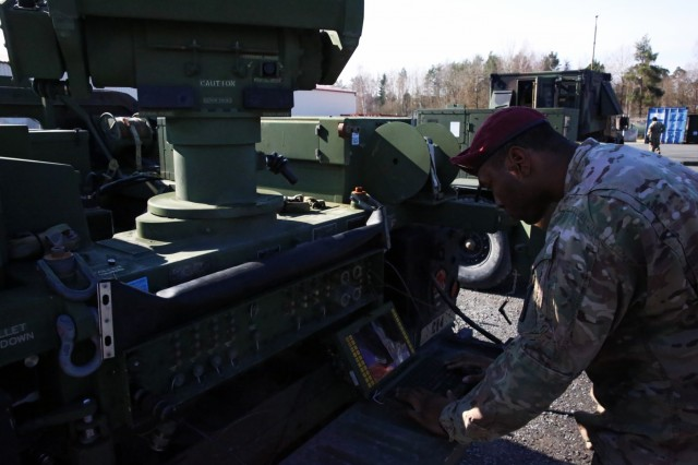 U.S. Army Spc. Tristan Edwards, a multichannel transmission systems operator-maintainer assigned to Charlie Company, 54th Engineer Battalion, 173rd Airborne Brigade, works to connect a Secure Mobile Anti-Jam Reliable Tactical Terminal during a SMART-T Rodeo hosted by 2nd Theater Signal Brigade, March 15, 2018 in Vilseck, Germany. (U.S. Army photo by William B. King)