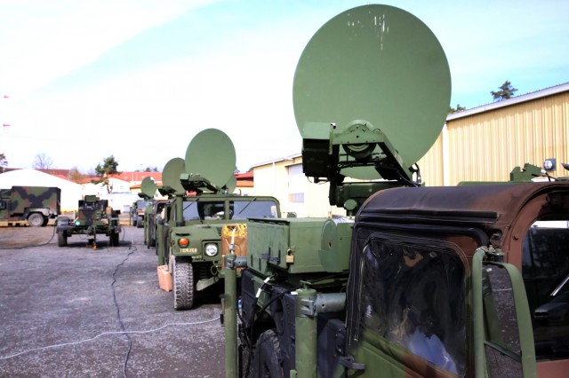 A row of Secure Mobile Anti-Jam Reliable Tactical Terminals seen during a SMART-T Rodeo hosted by 2nd Theater Signal Brigade, March 15, 2018 in Vilseck, Germany. (U.S. Army photo by William B. King)