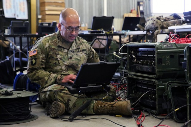 U.S. Army Staff Sgt. Andrew Scarborough, the nodal operations noncommissioned officer assigned to 2nd Cavalry Regiment, checks network connectivity provided from a Secure Mobile Anti-Jam Reliable Tactical Terminal during a SMART-T Rodeo hosted by 2nd Theater Signal Brigade, March 15, 2018 in Vilseck, Germany. (U.S. Army photo by William B. King)