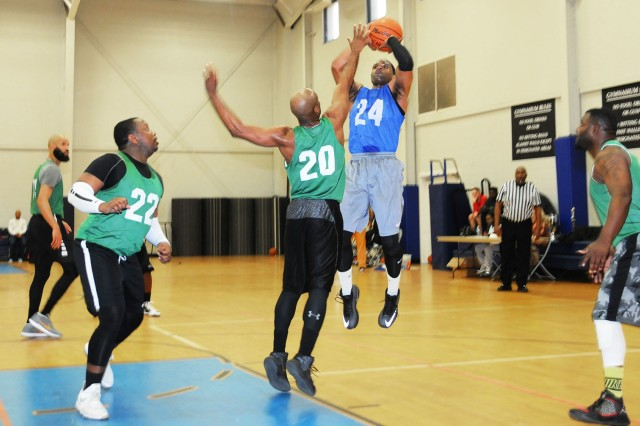 Senior Airman Tony Hart, player for the Champs, goes up for a shot during the league championship game of the Fort Rucker Intramural Basketball regular season March 12.