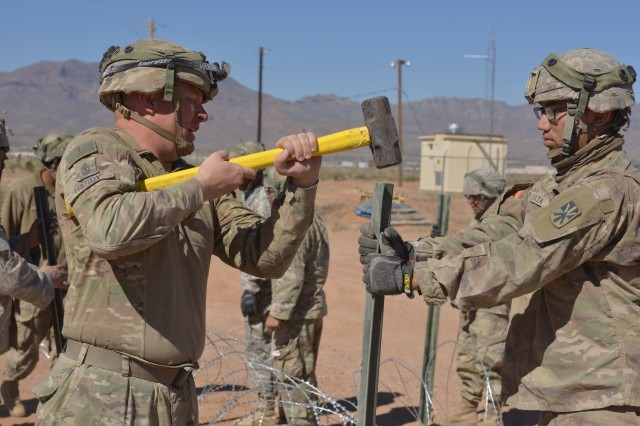 First Sgt. Jacob Allen Hardy uses a hammer to lay the foundation for a perimeter fence. Soldiers who participated in the March 2018 Roving Sands exercise had to move their units and set up new sites multiple times during the exercise.