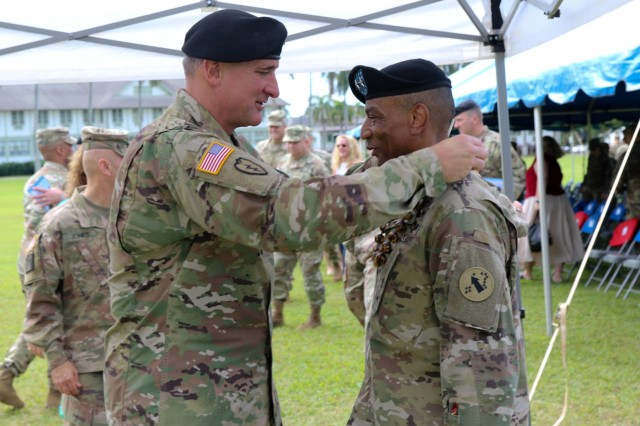 FORT SHAFTER, HI-- Gen. Robert B. Brown, the USARPAC commanding general, presents a lei to welcome Maj. Gen. Timothy M. McKeithen, deputy commanding general- National Guard, USARPAC, following a Flying V ceremony held at historic Palm Circle, Fort Shafter, Hawaii, March 15. The Flying V ceremony traditionally welcomes or honors senior Army officials when they assume duties or depart from an USARPAC. The V refers to the way the colors are posted during the ceremony, which is V-shaped.